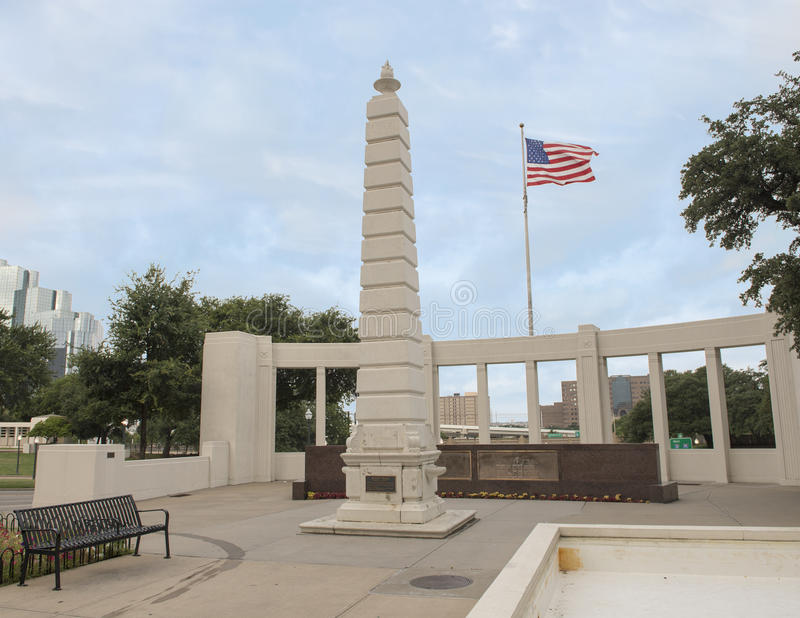 Monument and American Flag, Dealey Plaza, Dallas. Pictured is a monument in Dealey Plaza in Dallas, Texas. An American flag flying from a pole is in the royalty free stock images