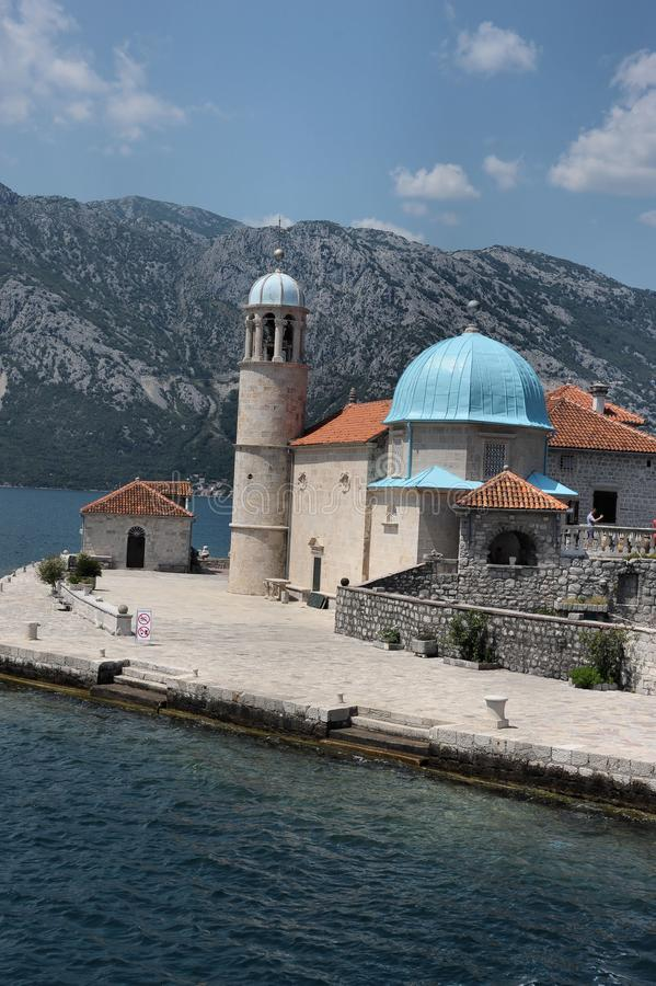 Island and Church of the Holy Mother of God in Boka - Kotorska Adriatic Bay, Montenegro, Europe. Monument of ancient architecture - the island and the stock photography