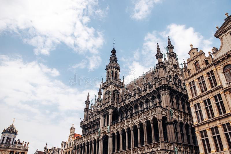 Monument of architecture against blue sky, bell tower, Gothic building bread house, Palace king, Museum keeps statue. Manneken Pis. Bottom view royalty free stock image