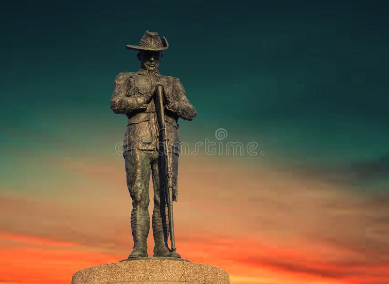 Anzac Day bridge soldier / digger monument with orange sky senset. The monument is of an Australian soldier, and on the eastern end of the bridge is a monument stock photos
