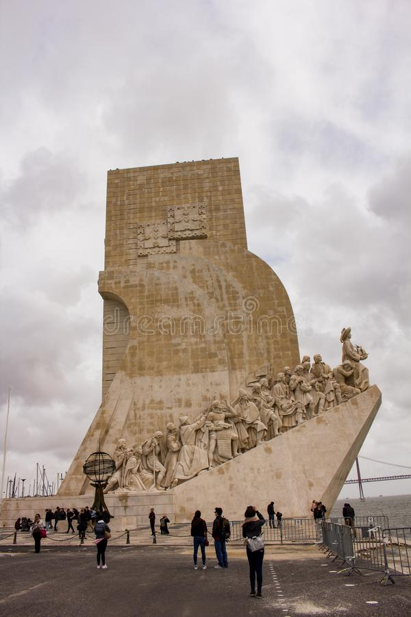 People near the Monument of Discoveries , Lisbon. Monument of the Discoveries is a monument on the northern bank of the Tagus River estuary, in the civil parish stock images