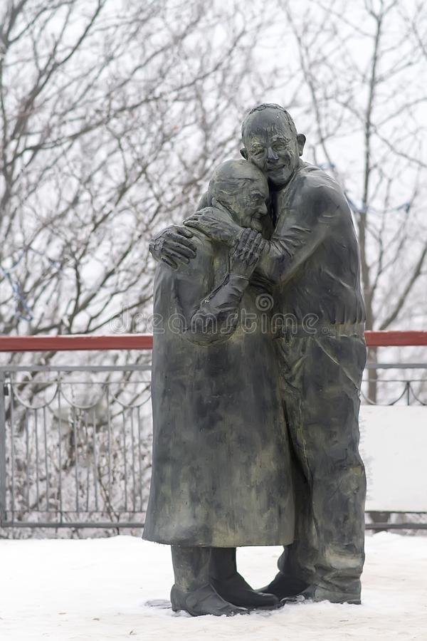 Monument of elderly lovers stock photos