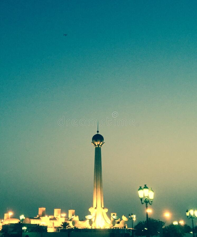 Monument in the evening sky. A high monument with an iron ball on top. stock images