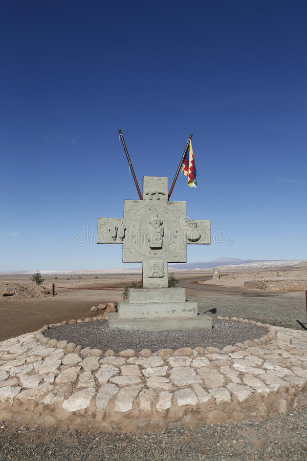 Monument with flag of Aymara people at the Valle de la Luna or Moon Valley royalty free stock images