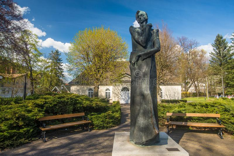 Monument of Frederic Chopin and classic Polish manor house royalty free stock photography