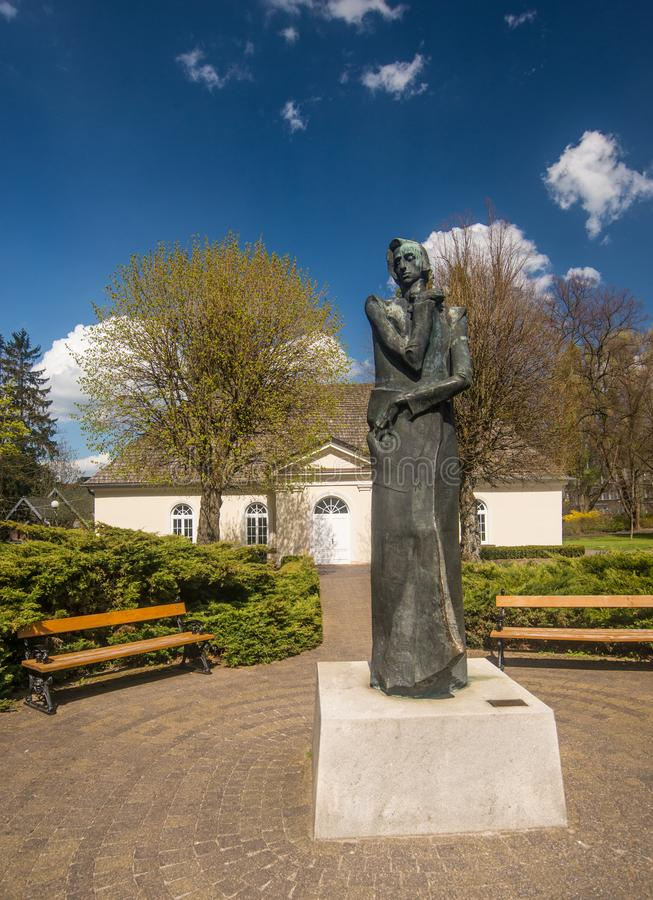 Monument of Frederic Chopin and classic Polish manor house royalty free stock images