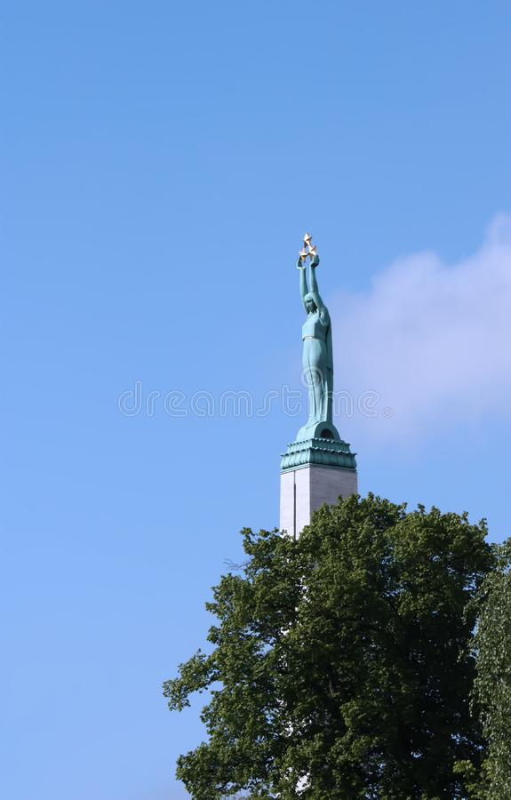 Monument of freedom in Riga. Historical monument of freedom in Riga. Woman holding three stars in her hands stock photos