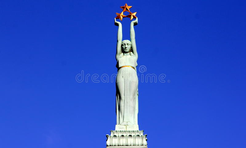 Download Monument Of Freedom In Riga, Latvia Stock Photo - Image of sword, people: 46601560