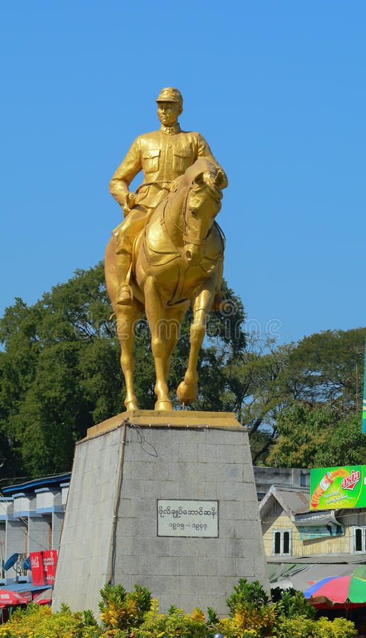 Monument of General Aung San. YANGON, MYANMAR - JAN 14, 2015. Monument of General Aung San with his horse in Yangon, Myanmar. He's considered Father of the stock photo