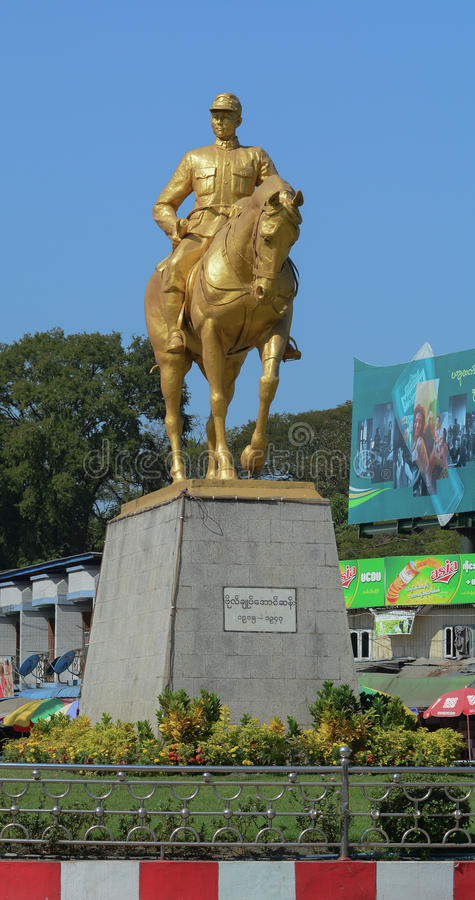 Monument of General Aung San. YANGON, MYANMAR - JAN 14, 2015. Monument of General Aung San with his horse in Yangon, Myanmar. He's considered Father of the royalty free stock images