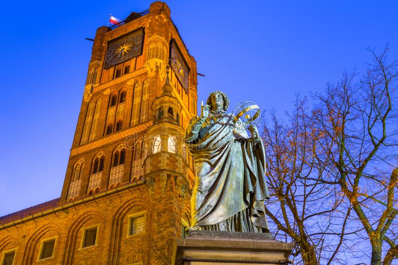 Monument of great astronomer Nicolaus Copernicus in Torun at dusk, Poland. Town, old, travel, tourism, europe, history, historic, historical, statue, building stock photos