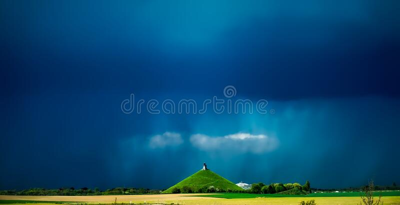 Monument on green hill stock image