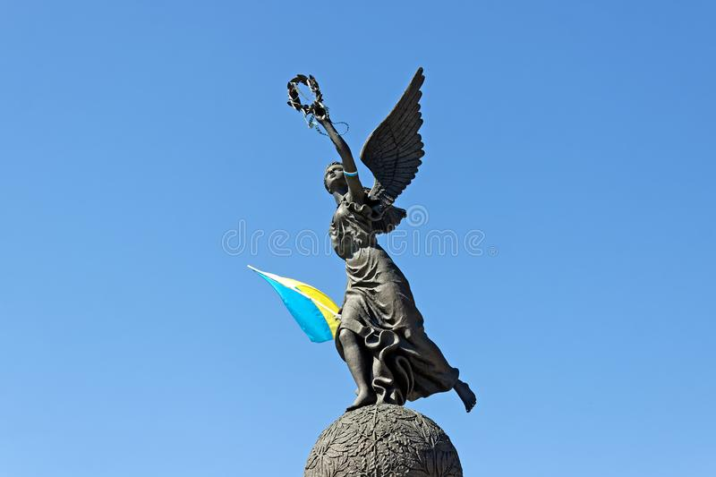 Ukraine Independence Monument in Kharkiv. Monument in honor of the Independence of Ukraine with flag in spring summer day at Constitution square in Kharkiv royalty free stock photography