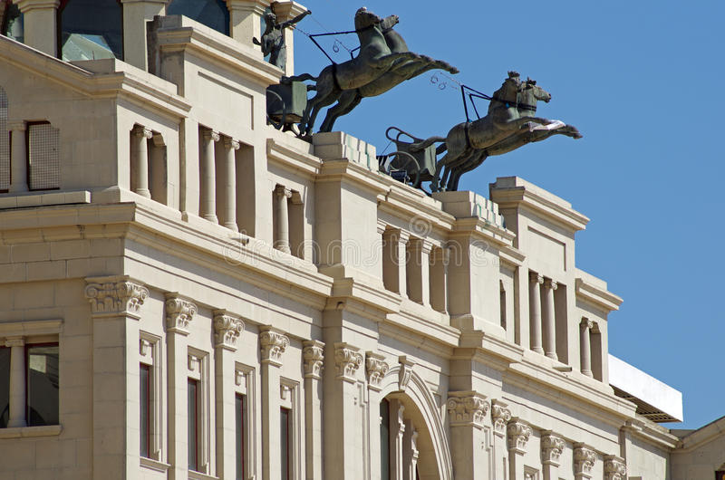 Monument with horses and warrior. On facade of Olympic stadium in Barcelona,Spain royalty free stock image