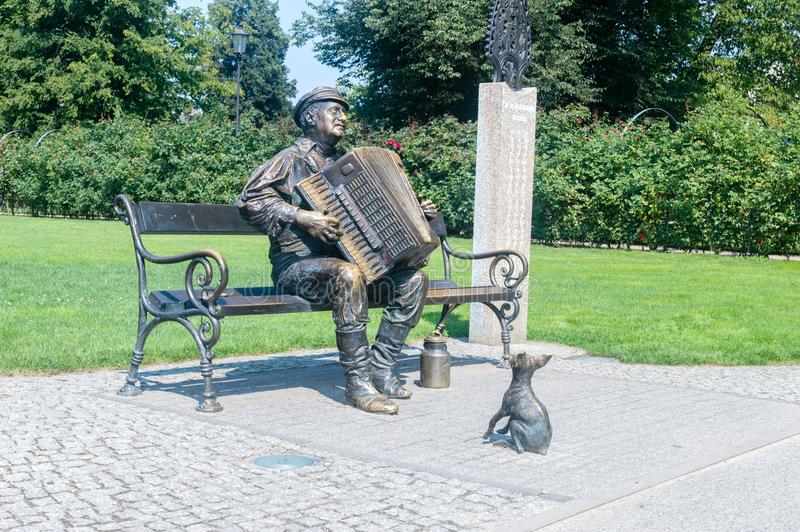 Monument of Kaszuby with accordion at park in Wejherowo. Wejherowo, Poland - August 2, 2018: Monument of Kaszuby with accordion at park in Wejherowo stock photo
