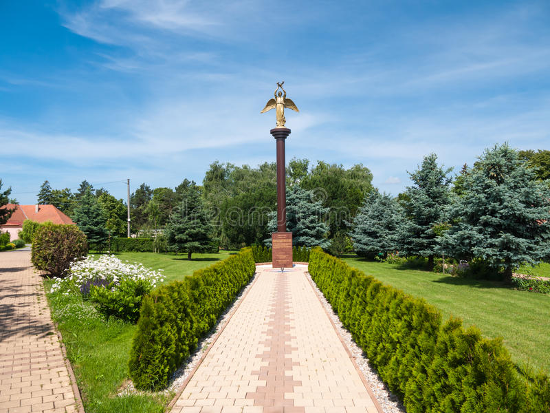 Monument of Kind Angel of Peace. RISNOVCE, NITRA REGION, SLOVAKIA - May 31, 2015: Statue of Good Angel of Peace in a local park, Risnovce stock photo