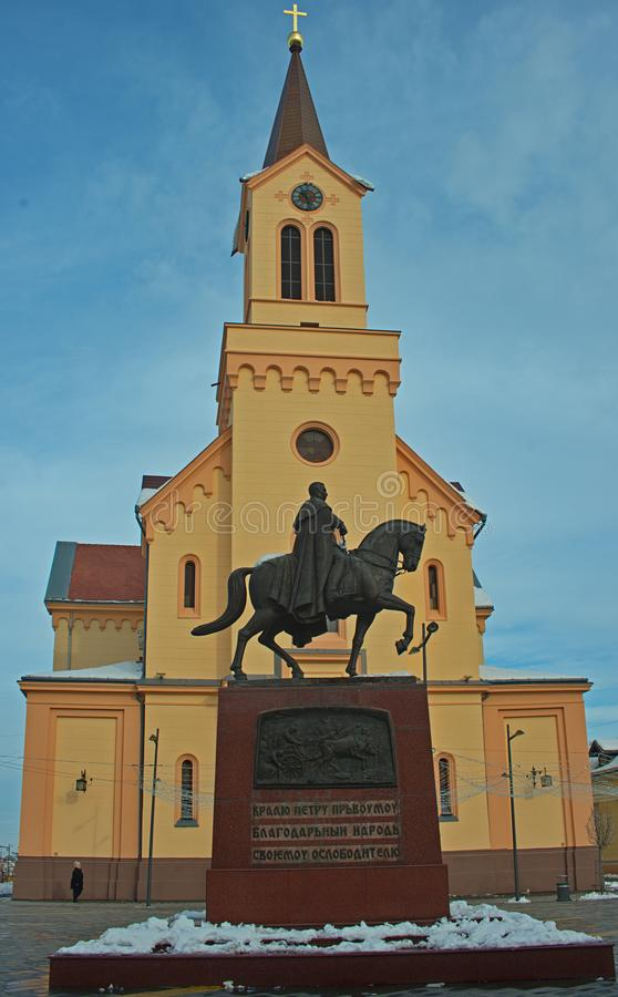 Monument of King Peter at the main square in Zrenjanin, Serbia. Monument of King Peter in front of a church at the main square in Zrenjanin, Serbia stock photo