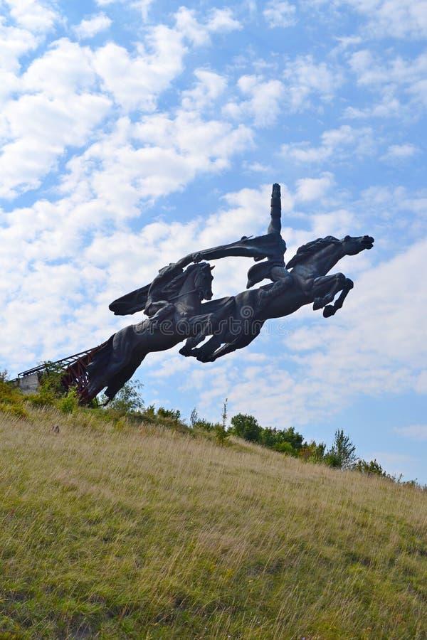 Monument Komsomol galloping on horseback stock images