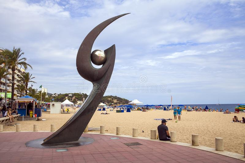 Monument Of L`Esguard In Lloret De Mar. Popular beach spot. Metal claw with the ball. Sculpture designed by Rosa Serra in commemoration of Meeting of Futbol stock photos