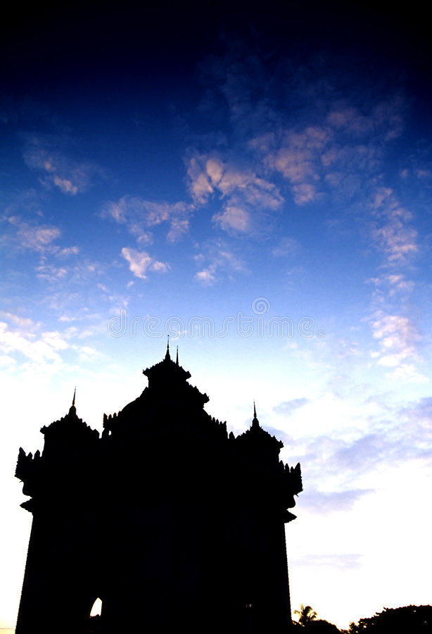 Monument- Laos. Patuxai monument in the capital city of Vientiane silhouetted at dawn, Laos stock photography