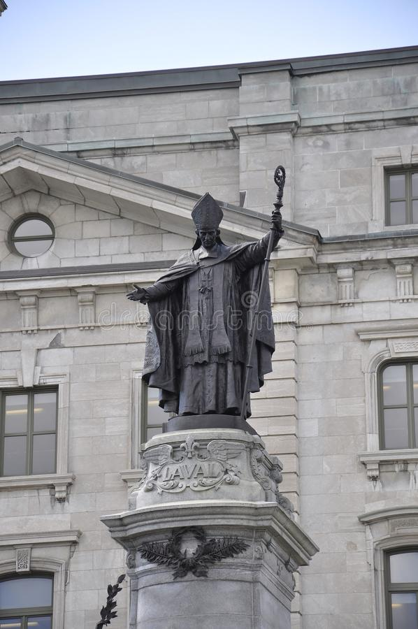 Monument of Monseigneur de Laval front of Post Office Building from Old Quebec City in Canada. On 28th June 2017 stock photos