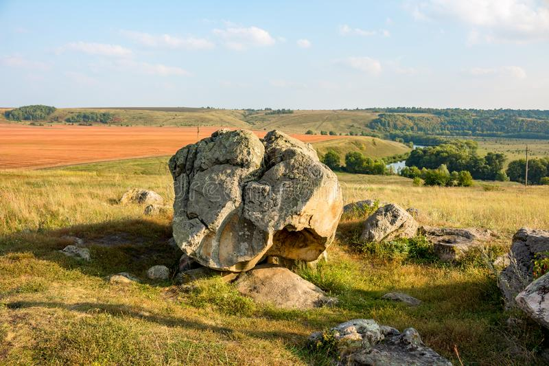 The monument of nature is megalith `Horse Stone` Kon kamen in the valley of the Krasivaya Mecha River. Kozie village, Efremovskiy district, Tulskiy region stock photos