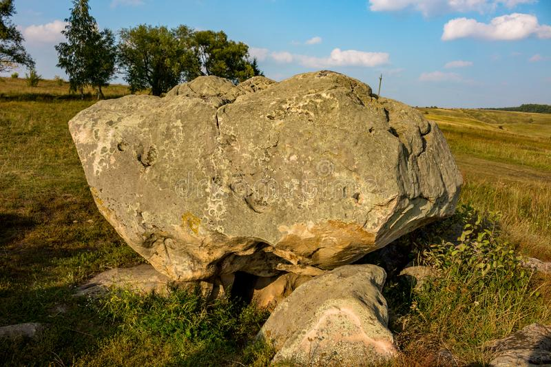 The monument of nature is megalith `Horse Stone` Kon kamen in the valley of the Krasivaya Mecha River. Kozie village, Efremovskiy district, Tulskiy region stock photography