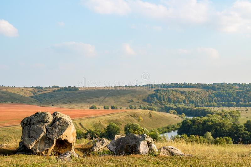 The monument of nature is megalith `Horse Stone` Kon kamen in the valley of the Krasivaya Mecha River. Kozie village, Efremovskiy district, Tulskiy region stock image