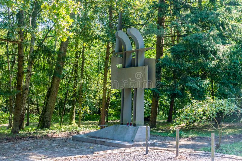 Monument in place where hard working prisoners of Nazi German camp in Stutthof. stock photos