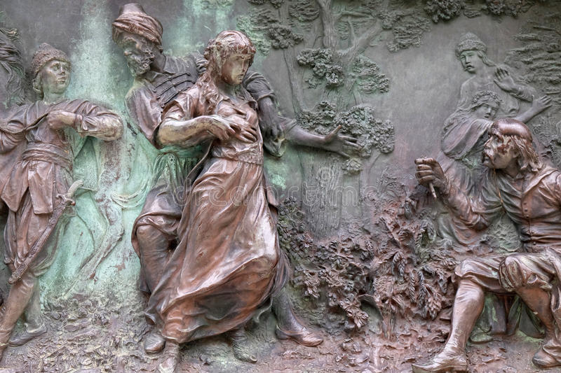 Monument of poet Ivan Gundulic in Dubrovnik. Relief on a monument of Ivan Gundulic in Dubrovnik. Scene from the ninth canto where Suncanica is taken to the stock images