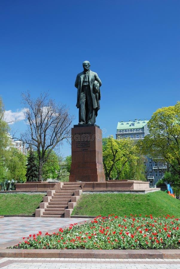 Monument of Shevchenko in spring public garden. Bronze statue is erected on granite pedestal in spring park of Kiev. This is the monument of famous Ukrainian royalty free stock images