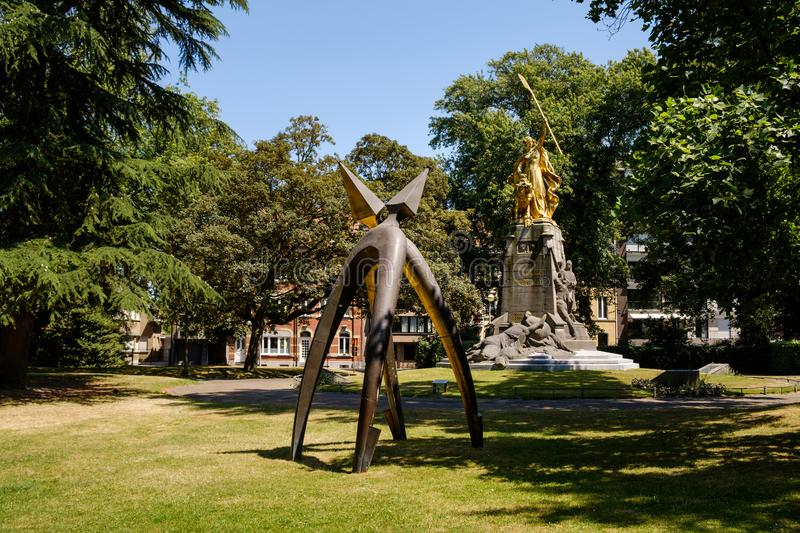 Monument 2 spurs - Battle of the Golden Spurs, Kortrijk, Flanders, Belgium. Kortrijk, Flanders, Belgium - JULY 1, 2018: Monument of 2 spurs in the Groeningepark stock images