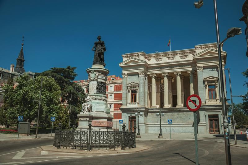 Monument on street in front of building in Madrid. Monument on street in front the west facade of Casón del Buen Retiro, an annex of the Prado Museum complex stock image