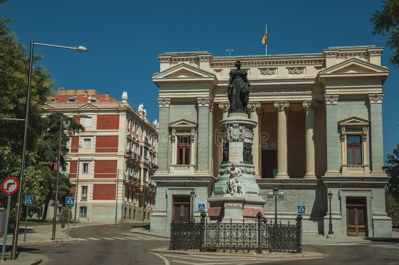 Monument on street in front of building in Madrid. Monument on street in front the west facade of Casón del Buen Retiro, an annex of the Prado Museum complex stock photo