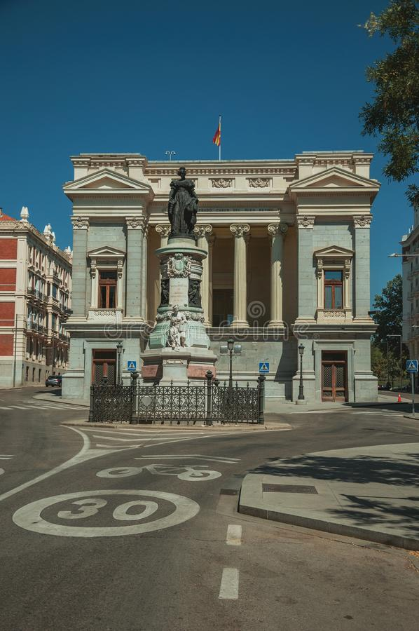 Monument on street in front of building in Madrid. Monument on street in front the west facade of Casón del Buen Retiro, an annex of the Prado Museum complex royalty free stock image