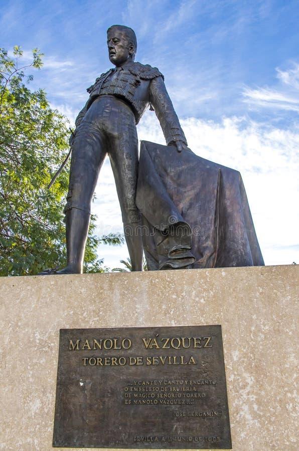 Monument till den berömda spanska tjurfäktaren Manolo Vazquez i Sev royaltyfria foton