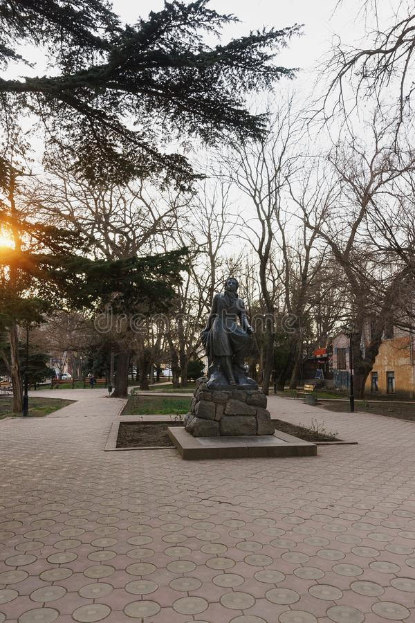 Monument to Alexander Pushkin in the city square of the same name. Bright ray of sunset royalty free stock images