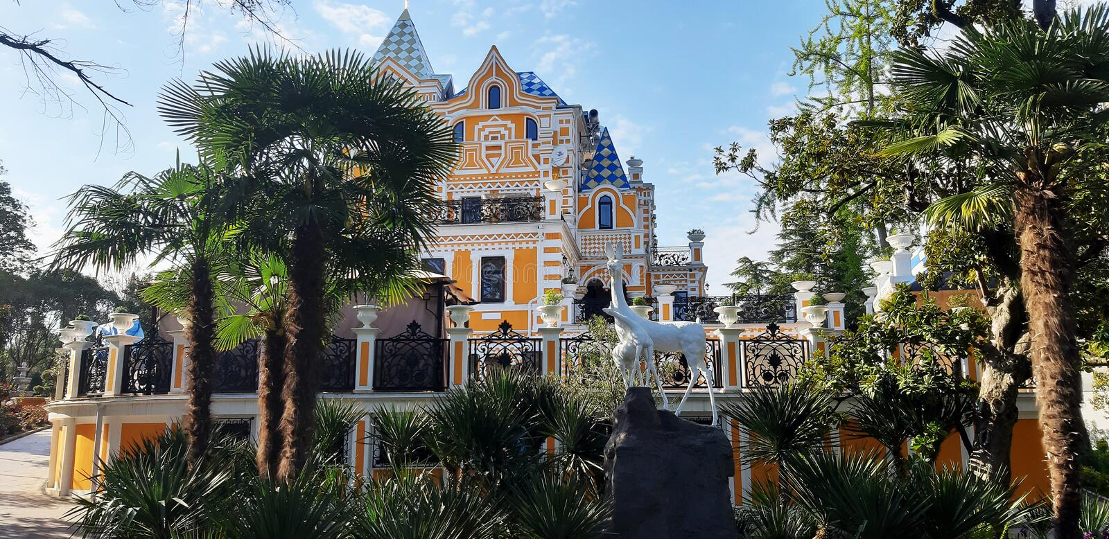 Monument to animals on the background of a beautiful house Riviera Park. Russia Sochi 04.28.2019 stock photo