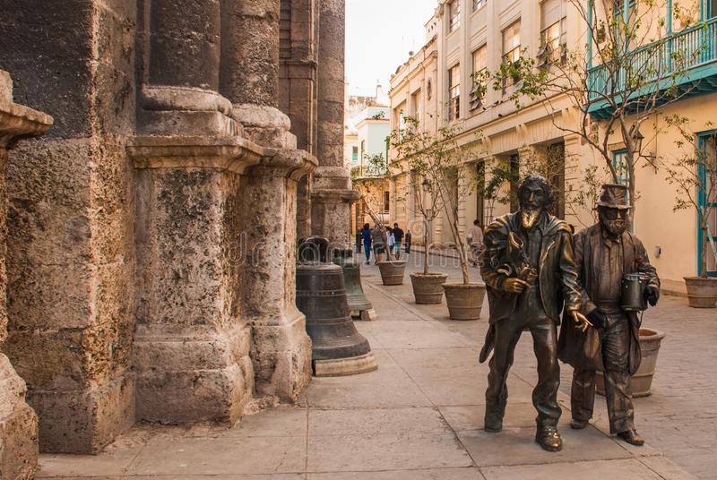 Monument to the city madman, monument to the tramp, the Knight of Paris, stands next to the Cathedral of St. Francis and a living royalty free stock photo