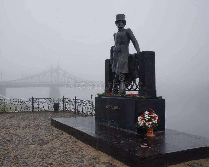 Monument to the great Russian poet Alexander Pushkin on the Volga river embankment in a thick morning fog stock photos