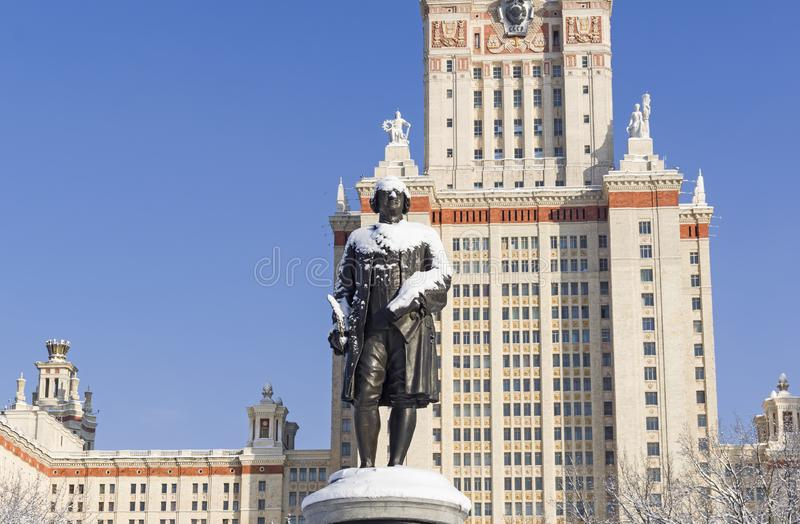 Monument to Lomonosov on the background of the Main Building of. Monument to the founder of Moscow University, Mikhail Vasilyevich Lomonosov against the royalty free stock photography