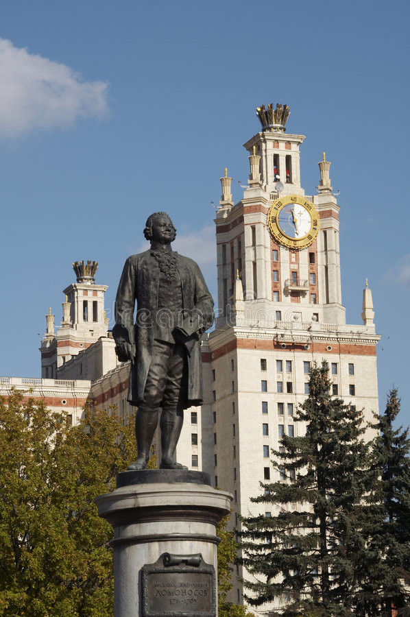The Monument to Mikhail Lomonosov. Near Moscow State University. There is a part of Moscow State University Main building behind it royalty free stock image