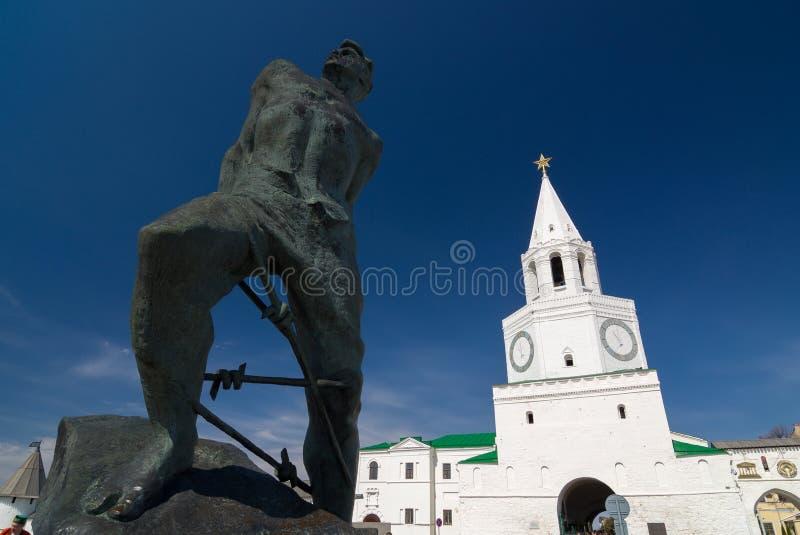 Monument to Musa Jalil and Spasskaya tower of the Kazan Kremlin. royalty free stock photo