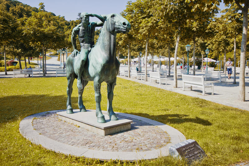Monument to naked horseman in park Casino Baden. Baden, Austria - 10 June, 2015: Monument to naked horseman in park Casino Baden royalty free stock photography