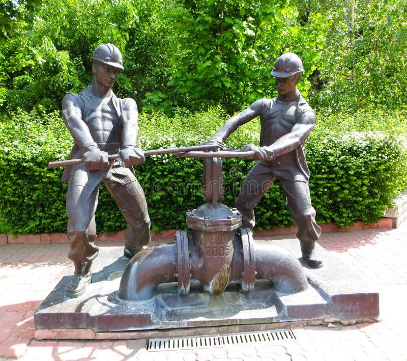 Monument to plumbers in Kremenchuk. Ukraine royalty free stock photo