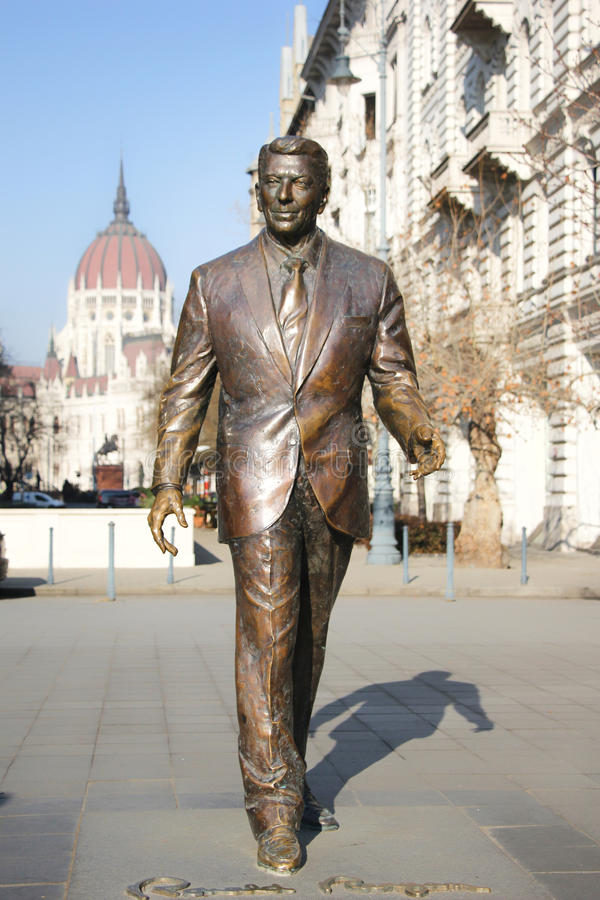 Monument to the president of the USA Ronald Reagan. Against Hungarian parliaments royalty free stock image