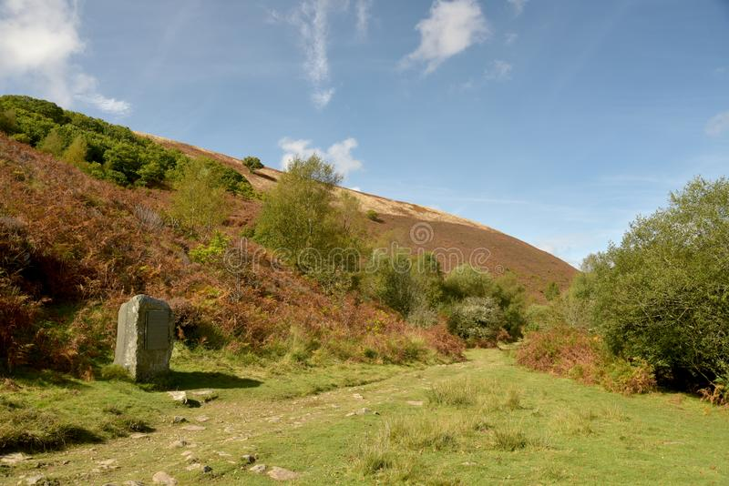 Monument to R D Blackmore, Doone Valley, Exmoor, North Devon. Footpath beside Badgworthy Water near monument to R D Blackmore, Doone Valley, Exmoor, North Devon stock photography