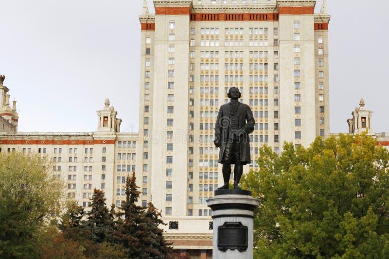 Monument to the scientist Mikhail Lomonosov. Main building. Russia. Monument to the scientist Mikhail Lomonosov. The monument is in front of Moscow State royalty free stock photos
