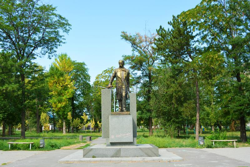 Monument to Taras Grigorievich Shevchenko in full growth, 12 meters and a green square. Beautiful monument on hillside overlooking the Samara River in the stock image