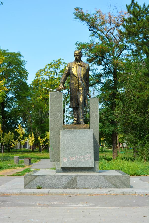 Monument to Taras Grigorievich Shevchenko in full growth, 12 meters and a green square. Beautiful monument on hillside overlooking the Samara River in the stock photography